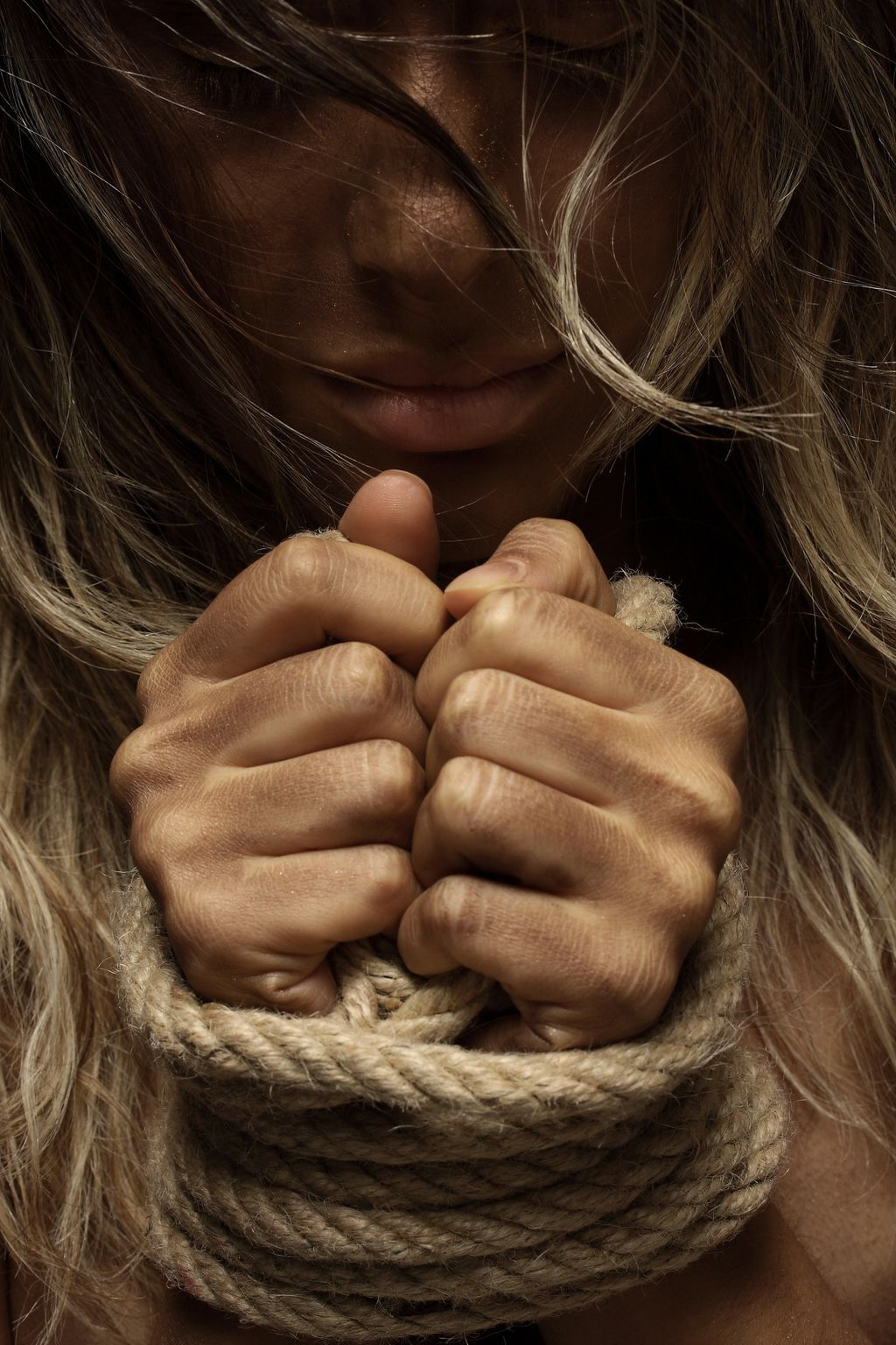 close-up-photo-of-woman-with-her-hands-tied-with-rope-1435441-k3sdskao