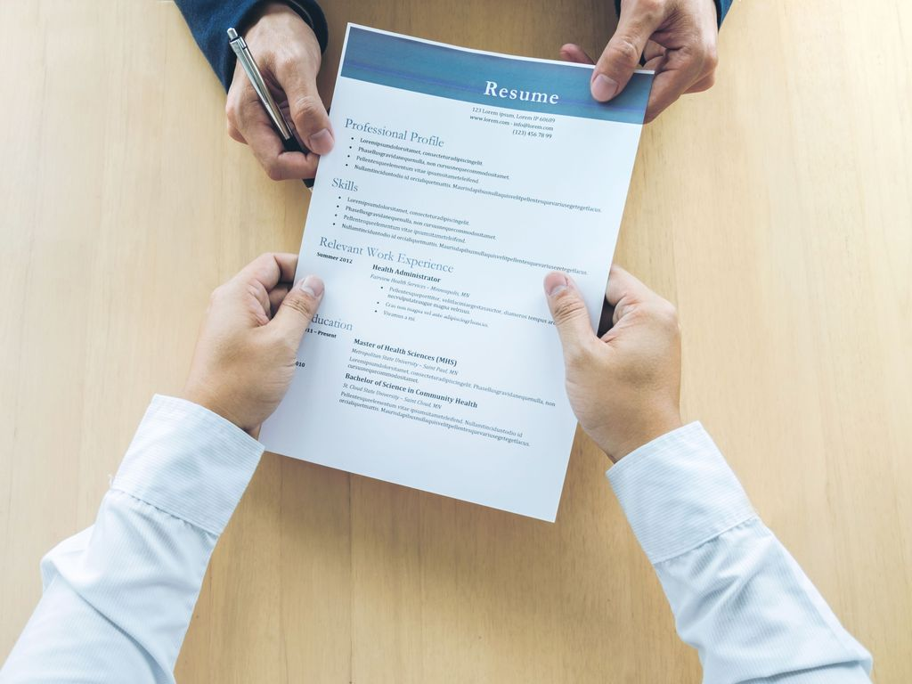 cropped-hands-of-business-people-holding-resume-on-table-in-office-944152896-5af32eb3ff1b7800204fa3d0-k1es18gt
