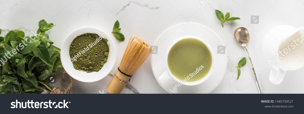 stock-photo-flat-lay-with-green-matcha-tea-mint-and-milk-on-white-table-1485759521-k0q8y0rx